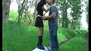 Couple trampling cuckold with boots