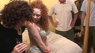 Plugging three holes on a ginger slut simultaneously