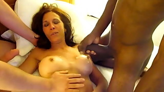 Filming cougar wife sucking black and white college cocks